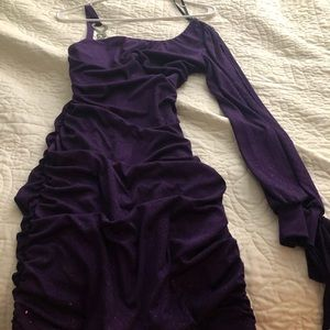 Purple fitted dress with rhinestone should accent